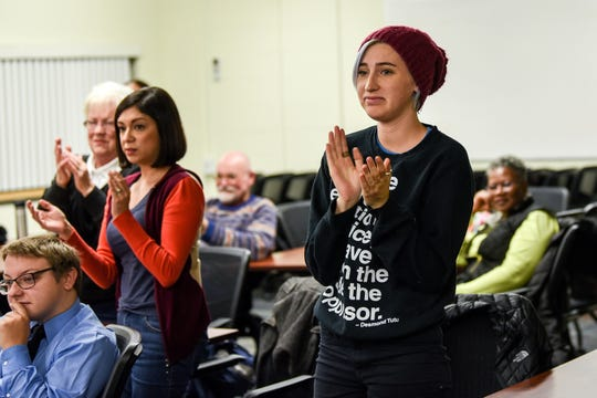 Survivor Strong founder and executive director Amanda Thomashow claps after an attendee voiced support of Casey Sterle during a community input session on Nov. 12, 2019, at Wainwright Elementary School in Lansing. Lansing School District acting Superintendent Mark Coscarella is accused of sexually harassing Sterle in 2002. The Michigan Association of School Boards hosted the meeting that was designed to collect feedback during Lansing School District's ongoing superintendent search.