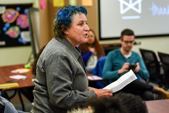 Mary Crowl, of Leslie, defends Casey Sterle during a community input session on Nov. 12, 2019, at Wainwright Elementary School in Lansing. Lansing School District acting Superintendent Mark Coscarella is accused of sexually harassing Sterle in 2002. The Michigan Association of School Boards hosted the meeting that was designed to collect feedback during Lansing School District's ongoing superintendent search.