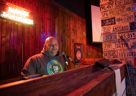 """JD Larner, known as """"DJ JD"""" pictured in Hit and Run  Karaoke Bar & Grill Wednesday, Nov. 13, 2019.  The karaoke bar is part of Overdrive, a new bar in the Lansing Mall in Delta Township that will feature live music, a DJ, and a karaoke bar."""