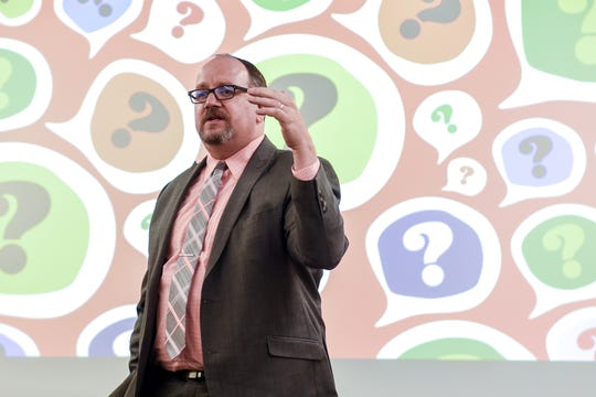 Jay Bennett, with the Michigan Association of School Boards, answers questions during a community input session on Nov. 12, 2019, at Wainwright Elementary School in Lansing. The Michigan Association of School Boards hosted the meeting that was designed to collect feedback during Lansing School District's ongoing superintendent search.