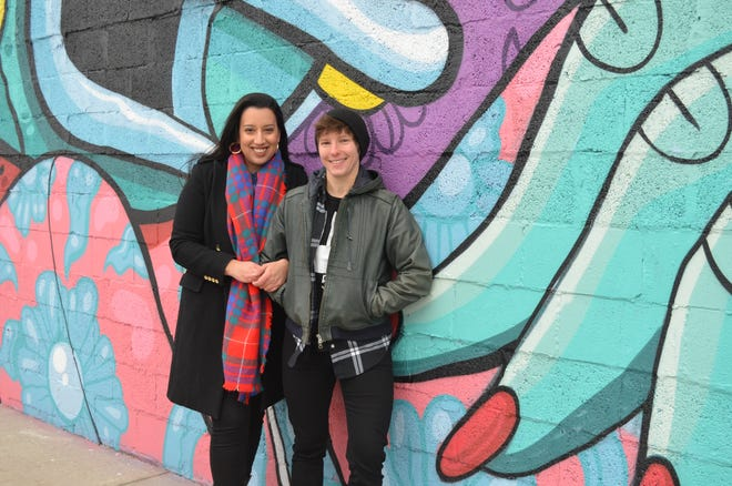 """Isabella Copeland (left) and Kyle Holsinger-Johnson hosted Queers Who Brunch at Allen Neighborhood Center last December. This is just one example of how Copeland has """"queered spaces,"""" or made them inclusive, in Lansing."""