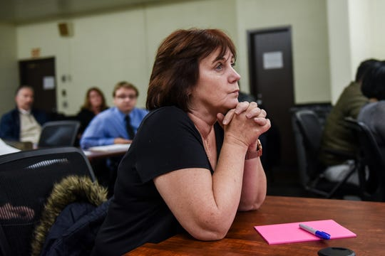 Lansing City Councilwoman Jody Washington listens during a community input session on Nov. 12, 2019, at Wainwright Elementary School in Lansing. The Michigan Association of School Boards hosted the meeting that was designed to collect feedback during Lansing School District's ongoing superintendent search.