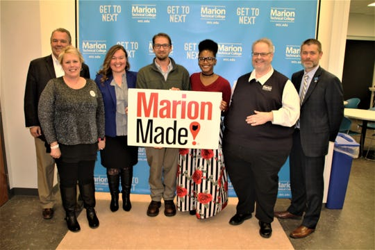 Jason Jordan and Jessica Coleman, holding MarionMade sign, are the 2019 winners of The Forge Business Plan Competition. Joining Jordan and Coleman in the photo are The Forge representatives, from left, Lars Olson, Tami Galloway, and Julie Welch. Also pictured are, far right, Marion Technical College faculty member Scott Hughes and MTC President Ryan McCall.