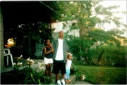 Jermeisha Nance (right) around age 9 and sister, Jada Allen (left) around age 10 with father, Keland Nance (center).