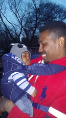 Lamorris Robinson, who was shot and killed on Oct. 16, is seen in this photo with one of his children.
