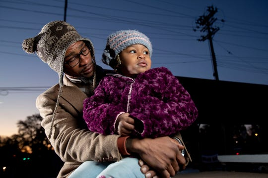 Keland Nance talks to his granddaughter, Nautica Powell, 3, on Nov. 12 at his property on the corner of Florida Street and East Mallory Avenue in Memphis. Nance's daughter, Jermeisha Nance, was killed in a shooting on Nov. 10.