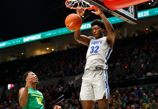 Memphis Tigers center James Wiseman dunks the ball over Oregon Ducks forward Shakur Juiston during their game at the Moda Center in Portland, Ore. on Tuesday, Nov. 12, 2019.