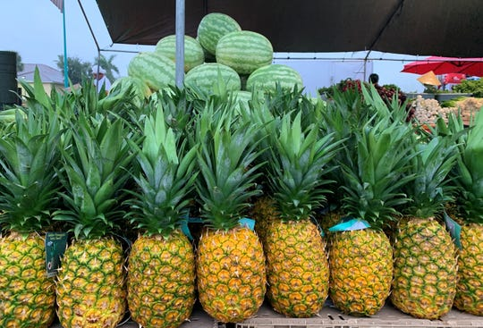 Pinapples and watermelon take center stage in this display at the Marco Island Farmer's Market on Wednesday, Nov. 13