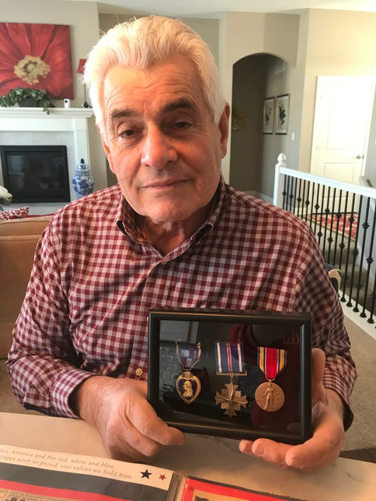 """Mike Bortolotti holds the medals his uncle Bruno Gaido earned during World War II. Gaido is portrayed by Nick Jonas in the new film """"Midway."""" Gaido, who grew up in Milwaukee, was promoted by Admiral William Halsey after Gaido jumped into a plane parked on the deck of the USS Enterprise to shoot down a Japanese plane attempting to crash into the aircraft carrier."""