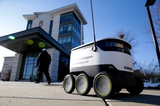 A robot in front of Dejope Residence Hall on the University of Wisconsin-Madison campus on Nov. 11. The university is the fourth in the country to try out the autonomous delivery bots.