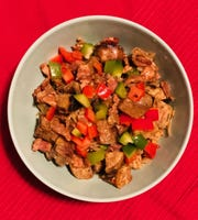 Fried plantains, bacon and bell pepper combine in this Puerto Rican-style dressing.