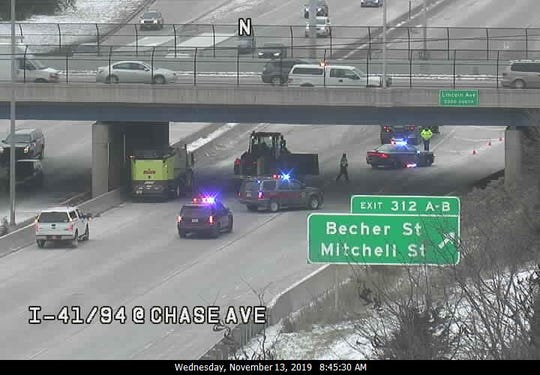 Milwaukee County highway crews and sheriff's deputies work to clean up the scene of a crash involving a semi on Wednesday.