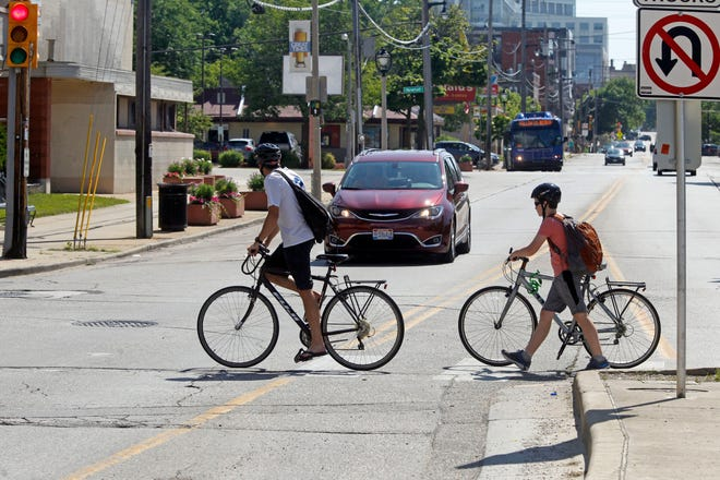 Bikers cross North Avenue  near North Newhall Street July 11 near the North Avenue bridge.