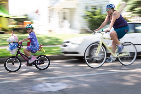 Cyclists bike south in the 2500 block of North Humboldt Boulevard during the Riverwest 24 bike race July 27.