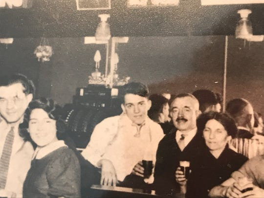 """Bruno Gaido, center, is pictured with his parents at right and sister, Flora, at the family's tavern in Milwaukee in the 1930s. The tavern is now the Harp Irish Pub. Gaido is portrayed by Nick Jonas in the new film """"Midway."""""""