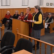 Baxter County Tax Collector Teresa Smith (standing left) and Baxter County Treasurer Jenay Mize (standing right) address the Quorum Court on Tuesday night about a proposed increase to the County General millage.