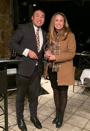 Ken Yang (left), Political Director of FCAC, presents a 2019 Statesman Award to Senator Missy Irvin.Irvin received the award for making an A on the 2019 Family Council Action Committee legislative report card.