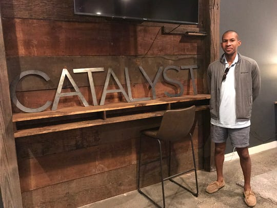 Joshua Mitchell is a co-founder of Catalyst. Neville High School students created the metal letters for the Catalyst sign.