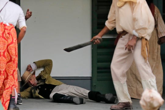 Plantation owner and slave owner Manuel Andry, portrayed by historian and photographer John,McCusker, is attacked by slaves during a performance artwork re-enacting of the largest slave rebellion in U.S. history in LaPlace, La.
