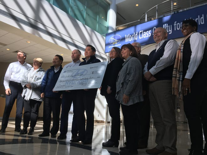 Hyundai Motor Manufacturing Alabama executives present a donation to United Way officials Wednesday at the plant.