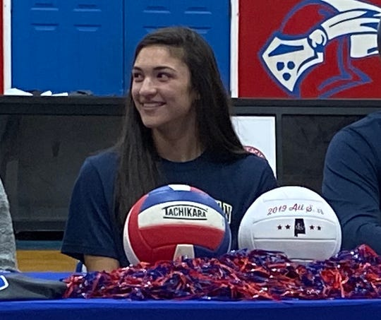 Macon-East's Emily Brooks signs with Texas Wesleyan volleyball on Wednesday.