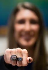 Alabama Christian pitcher Haley Pittman shows her championship ring as she signs with the Florida Gators at the ACA campus in Montgomery, Ala., on Wednesday November 13, 2019.