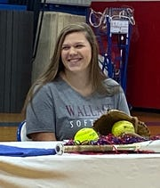 Macon-East's Caroline Capps signs with Wallace-Dothan Community College on Wednesday.