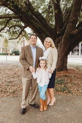 District Judge Adrian Johnson, Amanda (Mandy) Johnson, and daughter Harper C. Johnson, 7.