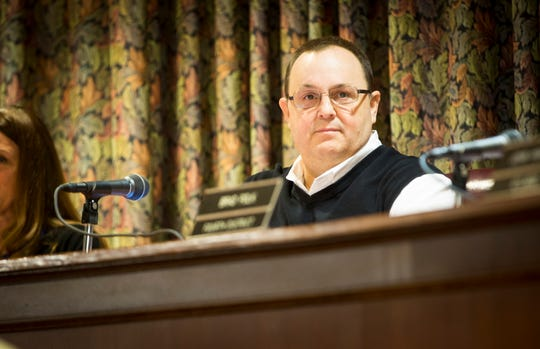 City Council President Doug Marshall looks over the crowd at the start of the November council meeting.