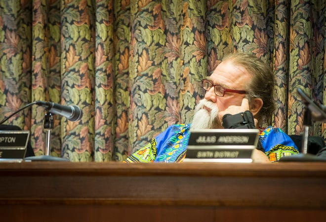 Council member John Hampton listens to another member of the public ask for his resignation during the November council meeting.
