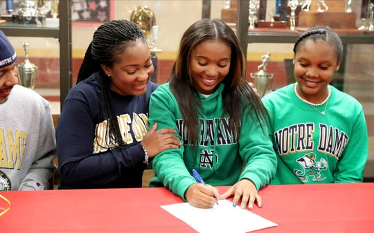 Riverdale's Alasia Hayes signs with Notre Dame basketball, on Wednesday, Nov. 13, 2019, at Riverdale. Pictured with Alasia is (left to right) her father Arnett, mother Sherry and sister Acacia.