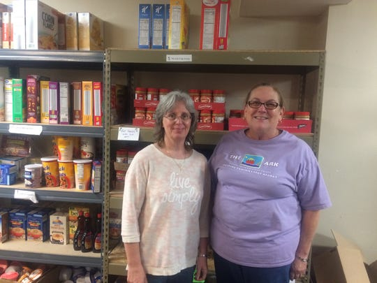 Jenny White and Anne Carty stand in the food pantry at The Ark in Pegram, serving people who are food insecure in southern Cheatham County.