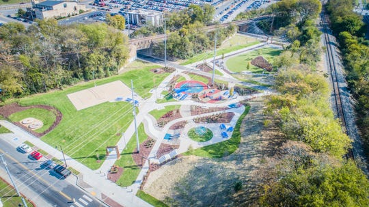 An aerial view of Frankie Pierce Park in downtown Nashville.  The 2.5-acre green space  connects Capitol View to a countywide greenway system of nearly 100 miles of paved trails via the Gulch Greenway extension that runs through the park. It features sand volleyball, a children's playground, a dog park and yoga lawn, and itaddresses a continued demand for green space downtown in wake of Nashville's development boom.