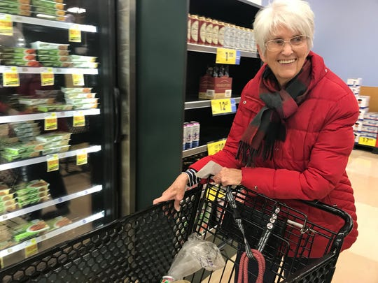Susan Grebel, a resident at Reddick Senior Residence, in Franklin rode a Church At West Franklin bus to the grocery store in Franklin.