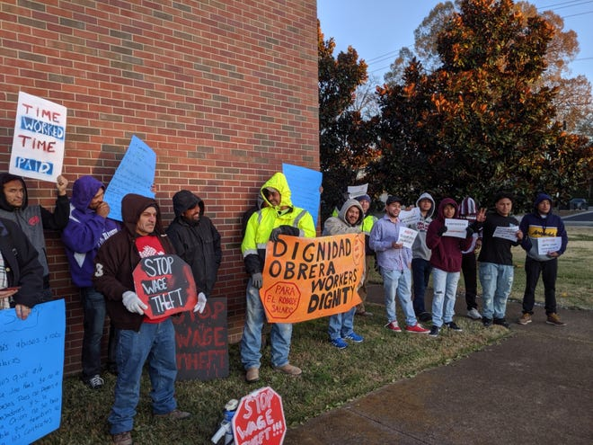 Workers of RSA Concrete protest outside of Metro Nashville Public Schools administrative offices on Nov. 13. The group alleged wage theft by a subcontractor used to renovate McMurray Middle School.