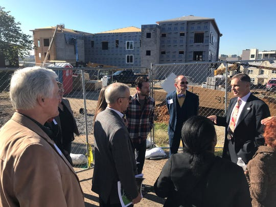 MDHA Executive Director Jim Harbison talks to Metro Council members about funding challenges during an October 23, 2019 tour of Cayce Place's redevelopment in East Nashville
