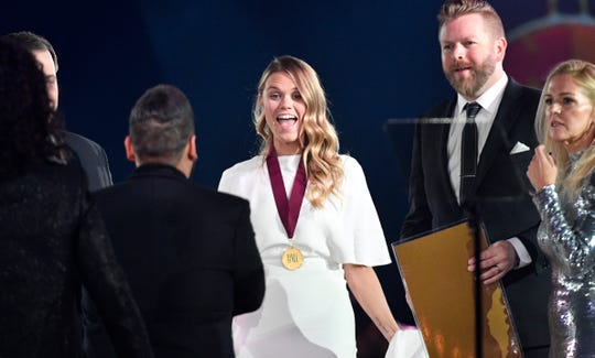 "Nicolle Galyon greets Dan + Shay as their song, ""Tequila,"" is honored at BMI's 67th Annual Country Awards  Tuesday, Nov. 12, 2019, in Nashville, Tenn."