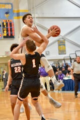 Myles Stute, a Vanderbilt signee, glides toward the basket for a layup for Gonzaga High in Washington, D.C.
