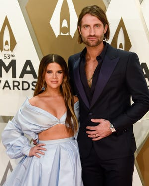 Maren Morris and Ryan Hurd walk the red carpet during the 53rd annual CMA Awards at Music City Center in Nashville on Nov. 13, 2019.