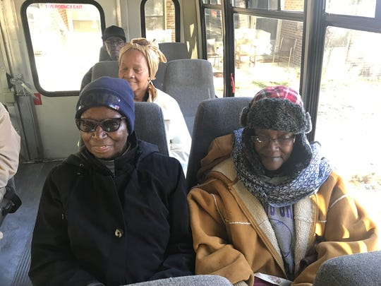 Cookie Brown (right) rides to Kroger on on The Church at West Franklin bus.