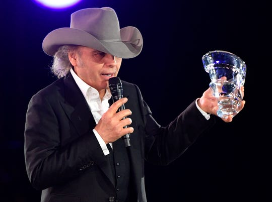 Dwight Yoakam holds his BMI Presidents Award at BMI's 67th Annual Country Awards  Tuesday, Nov. 12, 2019, in Nashville, Tenn.