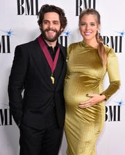 Thomas Rhett and wife Lauren Akins on the red carpet at BMI's 67th Annual Country Awards  Tuesday, Nov. 12, 2019, in Nashville, Tenn.