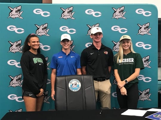 Gulf Coast High School held a signing ceremony for four athletes Wednesday. From left, softball player Kaylea Evans committed to USC Upstate, golfer Ryan Hart committed to Florida, golfer Jack Wehle signed with Barry University and beach volleyball player Montana Rae Pelak signed with Webber International.