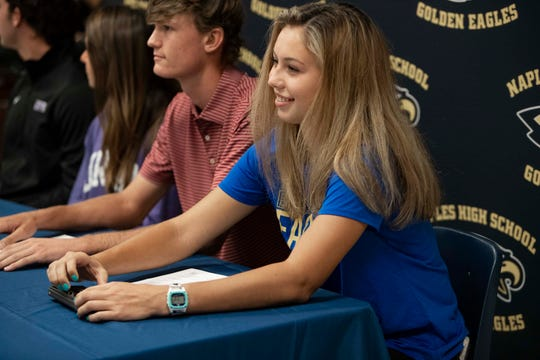 Sallie Squire, right  participates in a letter of intent signing ceremony, Wednesday, Nov. 13, 2019, at Naples High School. Squire will play lacrosse at Embry-Riddle Aeronautical University next year.