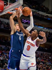 Nov 8, 2019; Dallas, TX, USA; Dallas Mavericks forward Kristaps Porzingis (6) blocks a shot by New York Knicks guard RJ Barrett (9) during the second half at the American Airlines Center.