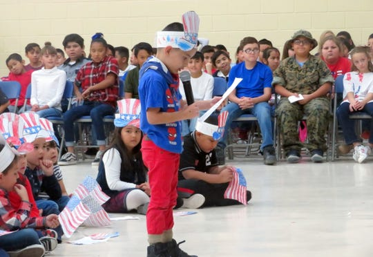 "Bataan Elementary School students paid respects to all veterans during its annual Veterans Day program on November 12 at the school. The entire program was student-led. The gym was filled with parents, grandparents, community members, and veterans. In top photo, Kindergarten student, Gaven Gasper, read the poem, ""On Veterans Day."" In bottom photo, The Gaffney-Oglesby Marine Corps League of Silver City, presented the colors as fourth-grade students from Gabriel Vidal's and Leigh Fisher's classes sang ""The Star-Spangled Banner."""
