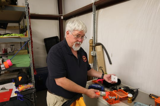 Eddy County Search and Rescue Coordinator Rick Wiedenmann shows off vital equipment used in missions.