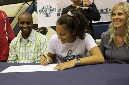 Piedra Vista's Elaina Watson signs her National Letter of Intent on Wednesday to continue her basketball career at NCAA Division II Adams State University.
