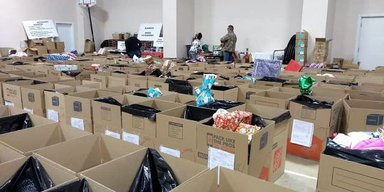 Rows of boxes await gifts, clothing and food to fill them.