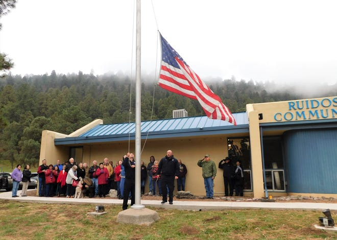 A flag raising ceremony on Veterans Day Monday brought together the mayor, several council members, residents and those who use the center.